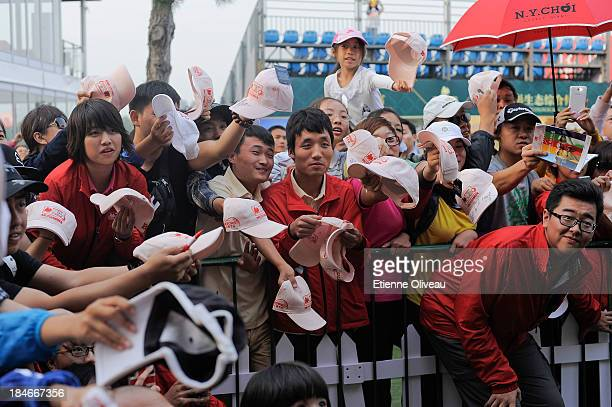 Golf fans ask for autographs after the first round of the Reignwood LPGA Classic at Pine Valley Golf Club on October 3 2013 in Beijing China