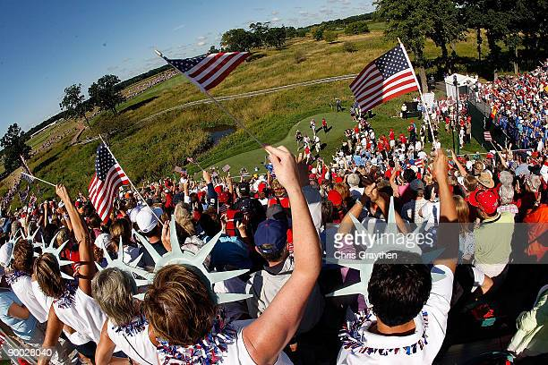 Golf fans cheer as the players approach the first tee during the Sunday singles matches at the 2009 Solheim Cup at Rich Harvest Farms on August 23...