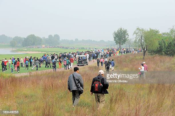 Golf fans follow the play during the final round of the Reignwood LPGA Classic at Pine Valley Golf Club on October 6 2013 in Beijing China