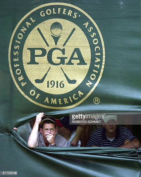 Golf fans sneak under the grand stands on the 18th hole 19 August 2001, at the 83rd PGA Championship at the Atlanta Athletic Club in Duluth, GA....