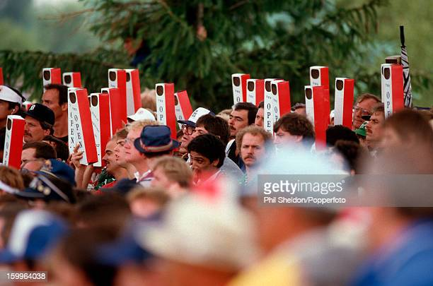 Golf fans using periscopes at the US Open Golf Championship hale at Oakland Hills Golf Club in Bloomfield Hills Michigan circa June 1985