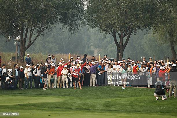Golf fans watch the play during the second round of the Reignwood LPGA Classic at Pine Valley Golf Club on October 4 2013 in Beijing China