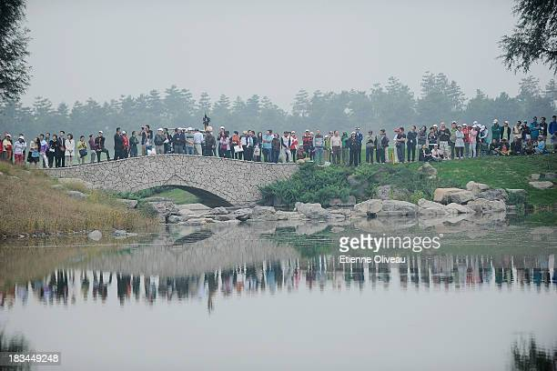 Golf fans watch the play on the 17th tee during the final round of the Reignwood LPGA Classic at Pine Valley Golf Club on October 6 2013 in Beijing...