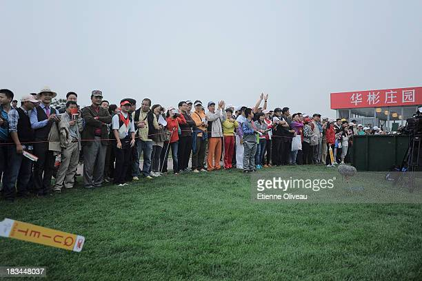 Golf fans watche the play during the final round of the Reignwood LPGA Classic at Pine Valley Golf Club on October 6 2013 in Beijing China