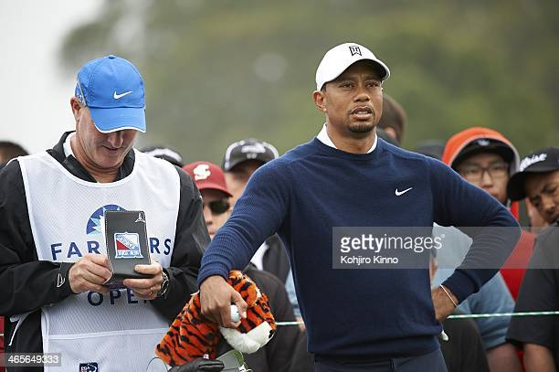 Farmers Insurance Open Tiger Woods and caddie Joe LaCava during Friday play at Torrey Pines GC La Jolla CA CREDIT Kohjiro Kinno