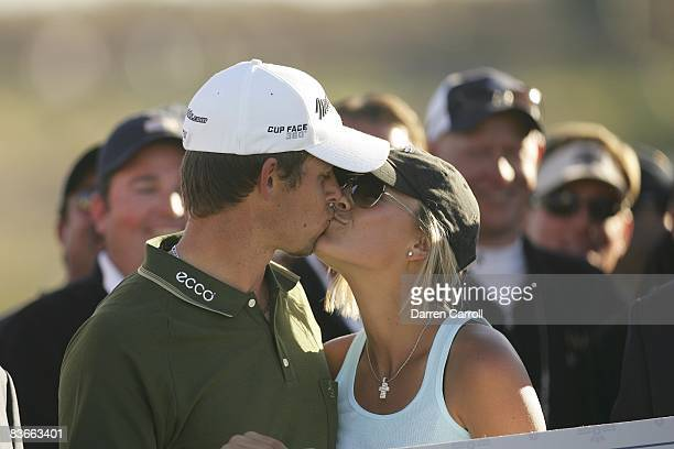 FBR Open Closeup of Aaron Baddeley victorious kissing wife Richelle after winning tournament on Sunday at TPC Scottsdale Scottsdale AZ 2/4/2007...