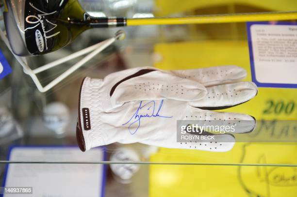 A golf glove signed and worn by Tiger Woods is on display at Julien's Auctions in Beverly Hills California on the first day of Julien's Music Icons...
