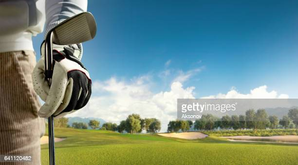 golf: golf course with a golf bag - golf flag stock photos and pictures
