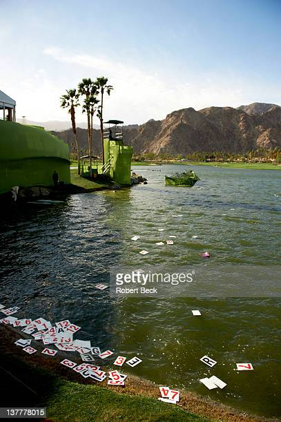 Humana Challenge: View of scoreboard cards knocked into water by wind on Saturday at La Quinta CC. Scores float in the water. La Quinta, CA 1/21/2012...