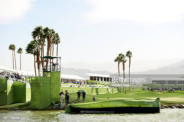 Humana Challenge: View of scoreboard knocked into water by wind on Saturday at La Quinta CC. Scores float in the water. La Quinta, CA 1/21/2012...