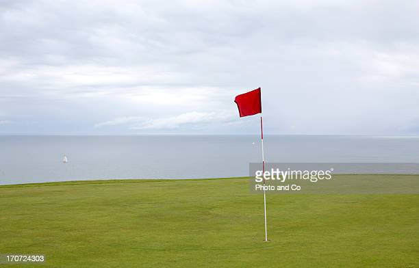 golf in etretat - golf flag stock pictures, royalty-free photos & images