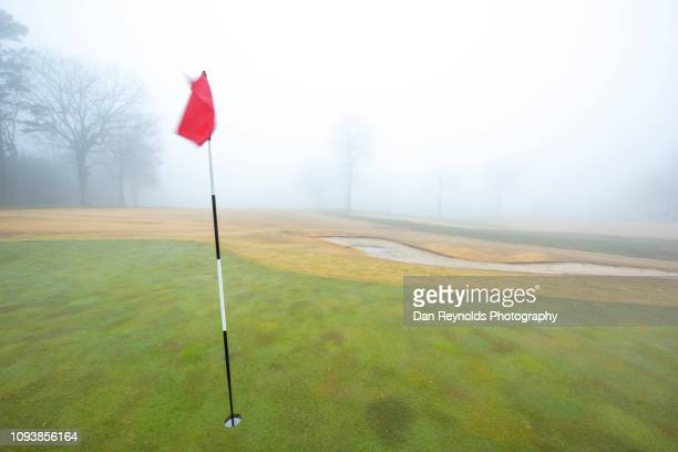 golf in fog - golf background stock photos and pictures