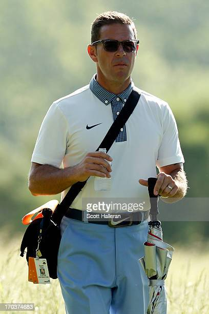 Golf Instructor, Sean Foley, looks on during a practice round prior to the start of the 113th U.S. Open at Merion Golf Club on June 12, 2013 in...