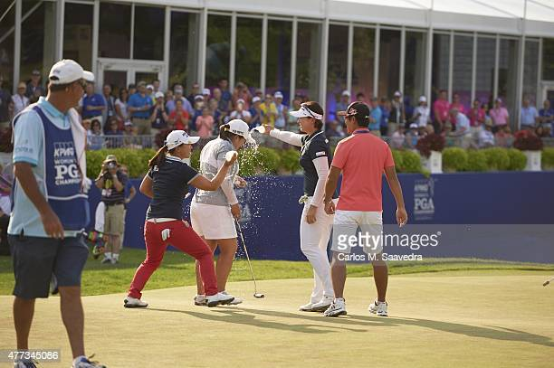 Womens PGA Championship: Inbee Park victorious, having water poured on her by friends after winning tournament on Sunday at Westchester CC. View of...
