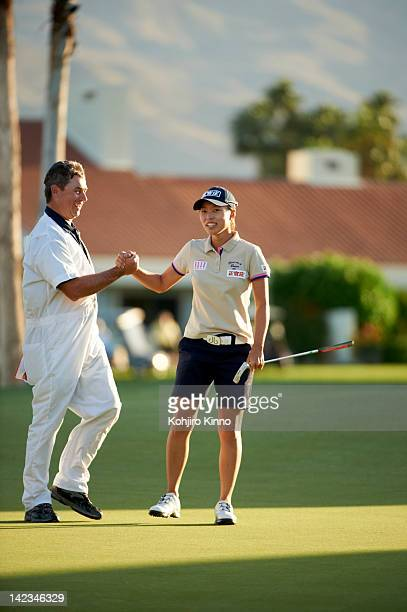 Kraft Nabisco Championship South Korea Sun Young Yoo victorious with caddie Adam Woodward during Sunday play at Mission Hills CC Rancho Mirage CA...