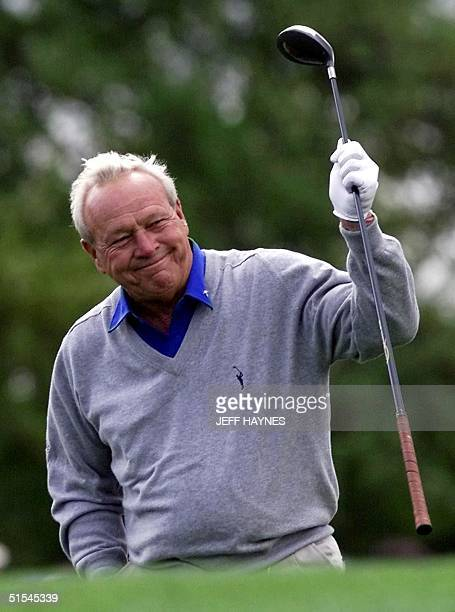 Golf legend and four time Masters winner Arnold Palmer of the US waves to the crowd after his tee shot on the first hole 04 April, 2000 during the...
