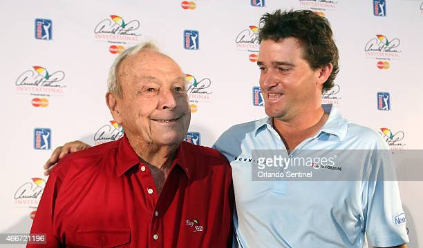 Golf legend Arnold Palmer left and his grandson Sam Saunders who is a professional golfer appear at a press conference Wednesday March 18 2015 at the...