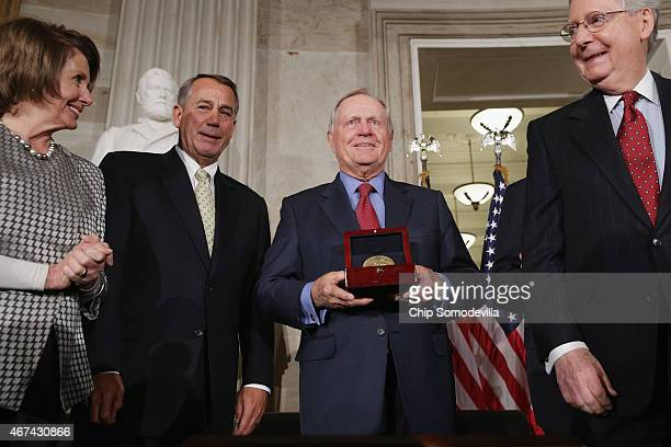 Golf legend Jack Nicklaus accepts the Congressional Gold Medal during a ceremony with House Minority Leader Nancy Pelosi Speaker of the House John...