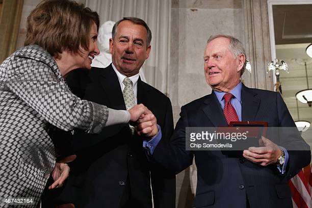 Golf legend Jack Nicklaus accepts the Congressional Gold Medal during a ceremony with House Minority Leader Nancy Pelosi and Speaker of the House...