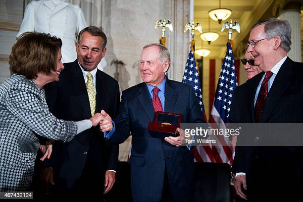 Golf legend Jack Nicklaus center is presented the Congressional Gold Medal by from left House Minority Leader Nancy Pelosi DCalif Speaker John...