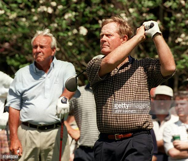 Golf legend Jack Nicklaus of the US tees off on the second hole with Arnold Palmer during their practice round for the 1998 Masters golf tournament...