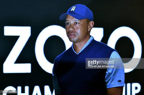 Golf legend Tiger Woods leaves a press conference room during the PGA golf tour, ZOZO championships in Narashino Country Club in Inzai city, Chiba...