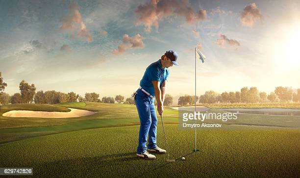 golf: man playing golf in a golf course - teeing off stock pictures, royalty-free photos & images