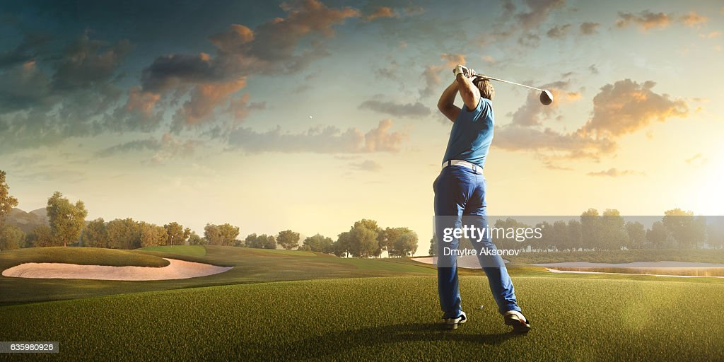 Golf: Man playing golf in a golf course : Stock Photo