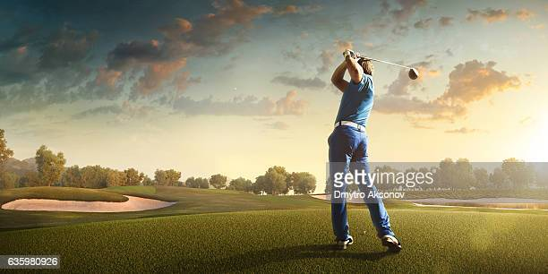golf: man playing golf in a golf course - golf swing stock pictures, royalty-free photos & images