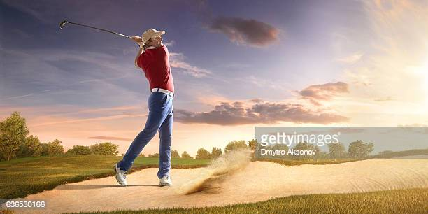 golf: man playing golf in a golf course - bunker stock pictures, royalty-free photos & images