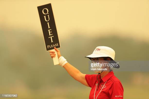 A golf marshal wears a face mask as smoke haze lingers during day one of the 2019 Australian Golf Open at The Australian Golf Club on December 05...