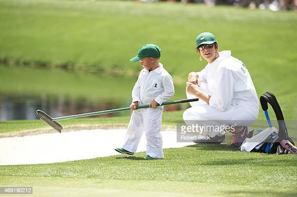 Masters Preview Angie Watson wife of Bubba Watson with their son Caleb Watson during Par 3 Tournament on Wednesday at Augusta National Augusta GA...