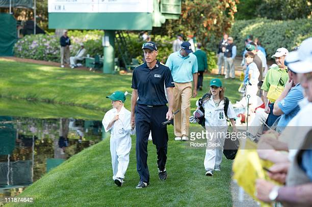 Masters Preview Jim Furyk walking with his daughter Caleigh Lynn and son Tanner James during Par 3 Contest on Wednesday at Augusta National Augusta...