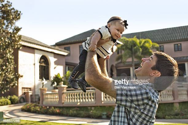 Masters Preview: Portrait of Bubba Watson with his daughter Dakota during photo shoot at Isleworth G&CC. Windermere, FL 3/16/2015 CREDIT: Ben Van Hook