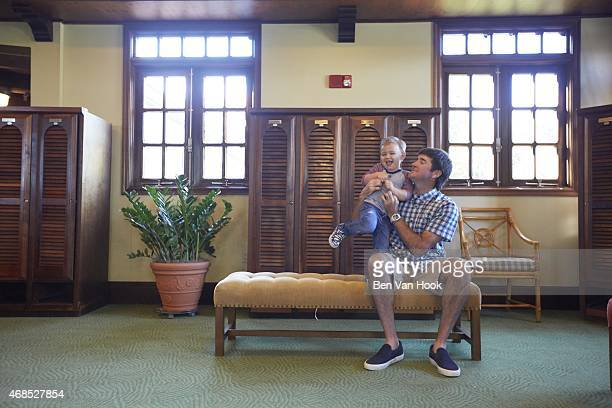 Masters Preview: Portrait of Bubba Watson with his son Caleb during photo shoot in the men's locker room at Isleworth G&CC. Windermere, FL 3/16/2015...