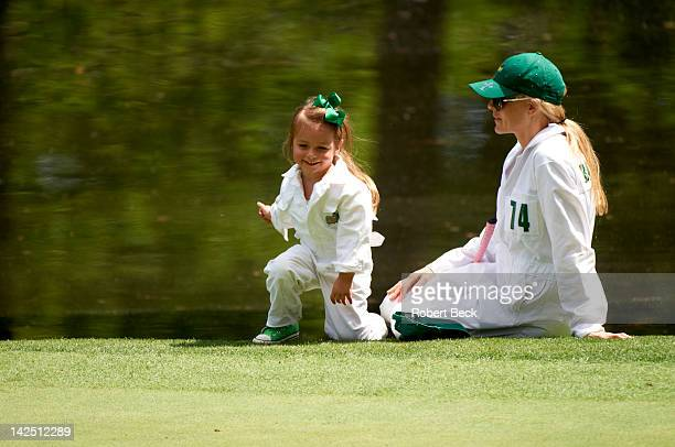 Masters Preview Richelle Baddeley wife of Aaron Baddeley with their daughter during Par 3 tournament on Wednesday at Augusta National Augusta GA...