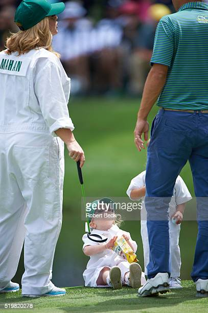 Masters Preview View of Kandi Mahan wife of Hunter Mahan with their daughter Zoe during Par 3 tournament on Wednesday at Augusta National Augusta GA...