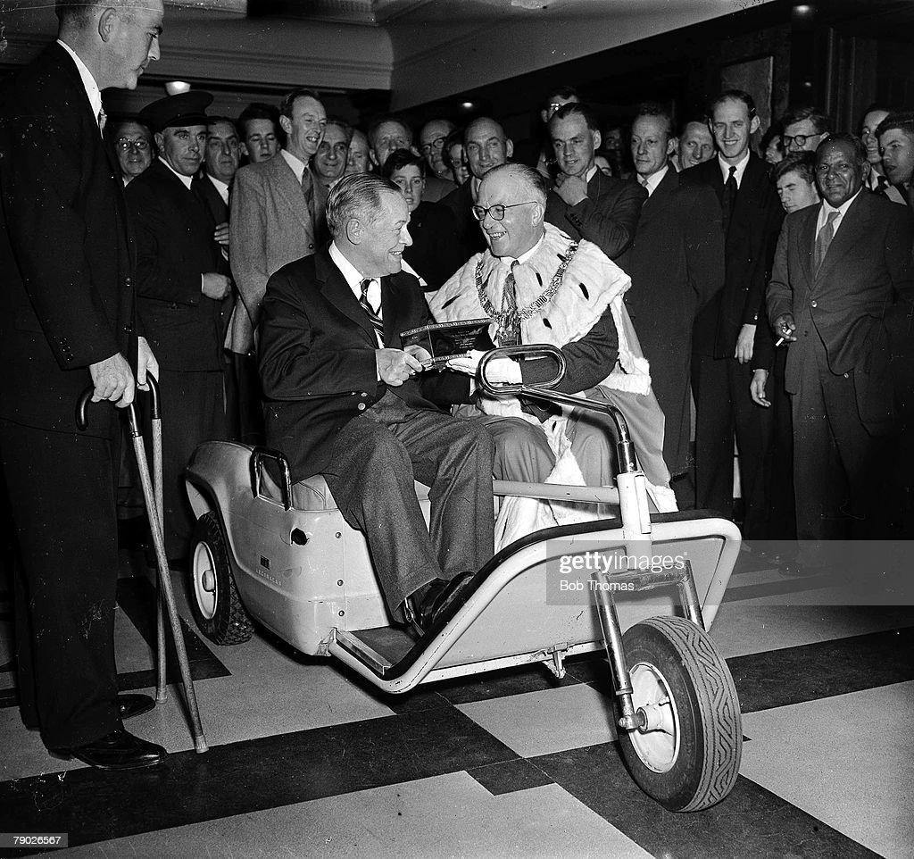 Golf: October 1958. St Andrews, Scotland. Legendary American golfer Bobby Jones is pictured receiving the Freedom of St Andrews, sitting in his special golf buggy. : News Photo