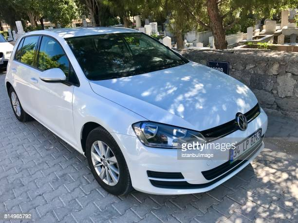 vw golf parking in the street - 2017 stock photos and pictures