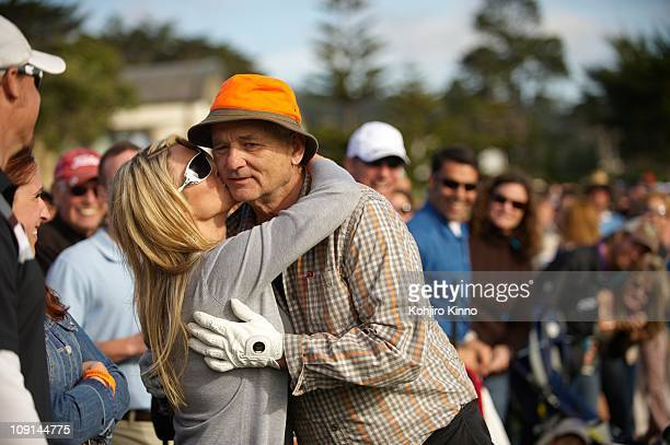 Pebble Beach National ProAm Celebrity actor Bill Murray receiving kiss from fan in gallery during Sunday play at Pebble Beach Golf LinksPebble Beach...