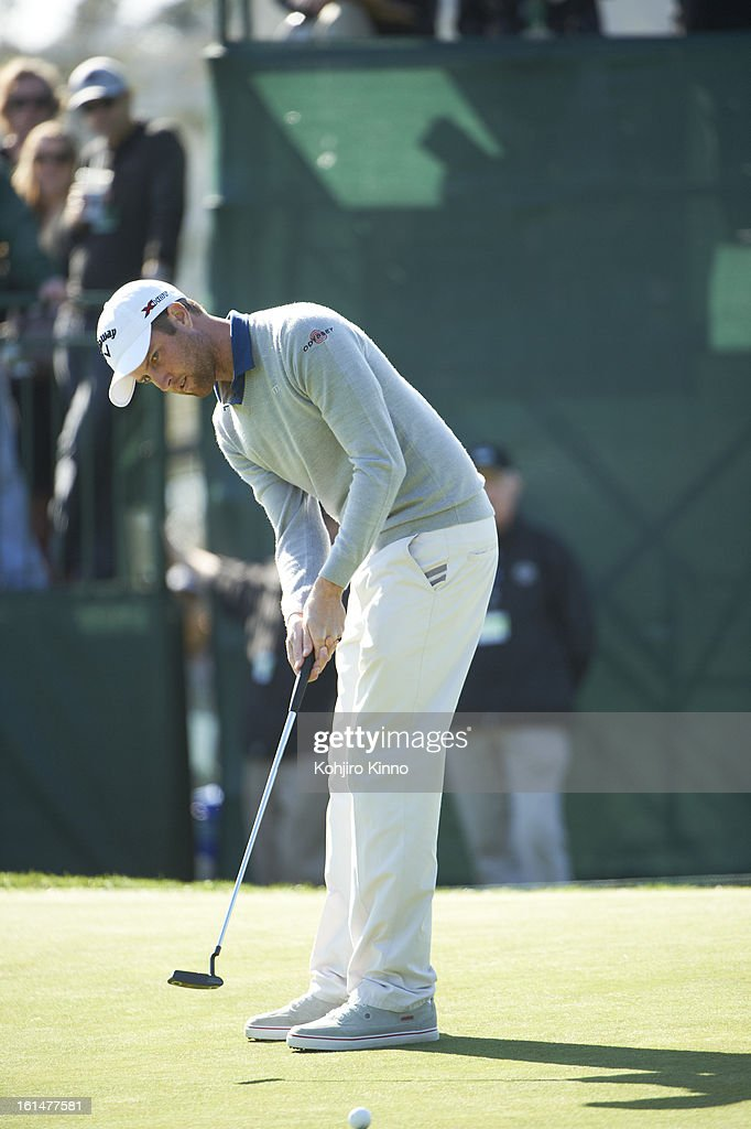 Chris Kirk in action, putt during Sunday play at Pebble Beach Golf Links. Kohjiro Kinno F223 )