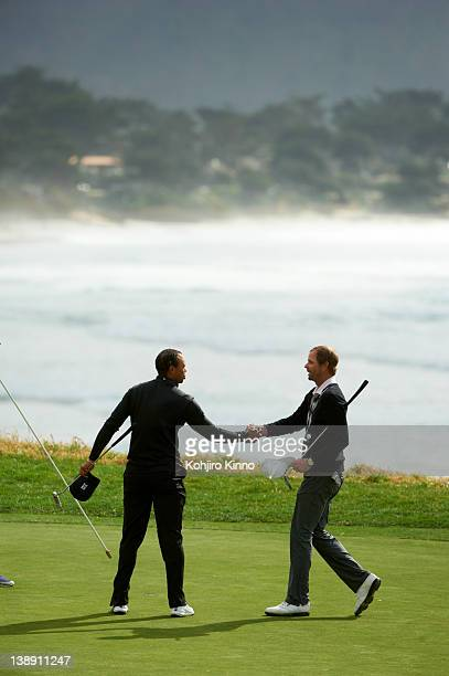 Pebble Beach National ProAm Tiger Woods shaking hands with fellow golfer during Saturday play at Spyglass Hill GC Pebble Beach CA CREDIT Kohjiro Kinno