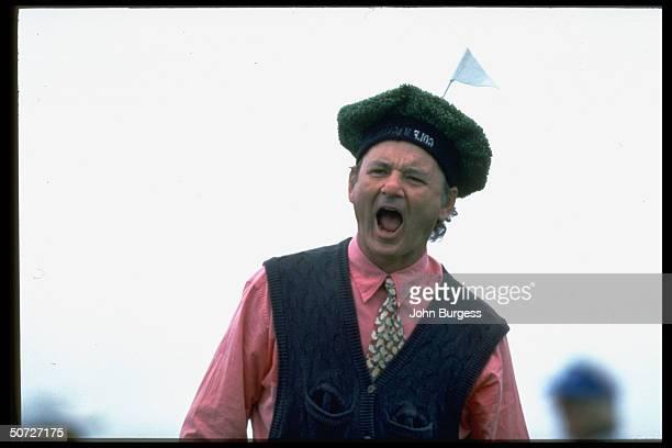 Pebble Beach Pro Am. Closeup portrait of actor Bill Murray alone.; Murray wearing goofy hat, yelling.;