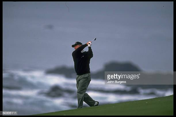 Pebble beach Pro Am. Mark O'Meara in action alone, driving during tournament.