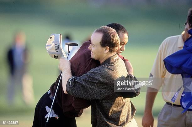 Golf PGA Championship Closeup of Bob May hugging Tiger Woods after losing Sunday playoff at Valhalla CC Louisville KY 8/20/2000