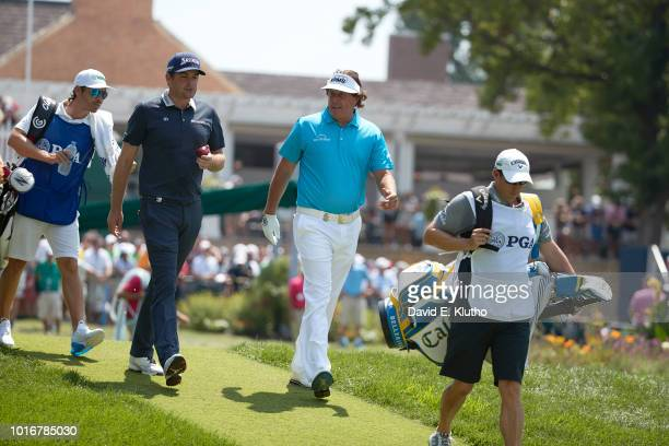 PGA Championship Keegan Bradley walking with Phil Mickelson during second round play on Friday at Bellerive CC Round 2 carried over into Saturday...