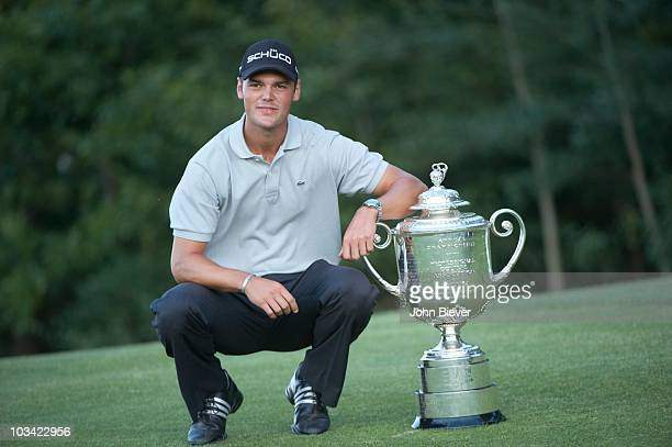 Championship: Martin Kaymer victorious, holding Rodman Wanamaker Trophy after winning tournament during Sunday Playoff at Straits Course of Whistling...