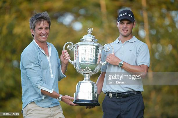 PGA Championship Martin Kaymer victorious holding Rodman Wanamaker Trophy with agent Johan Elliott after winning tournament during Sunday Playoff at...