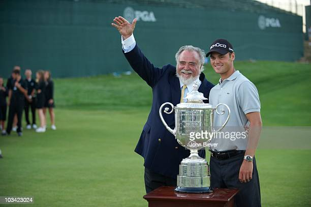 Championship: Martin Kaymer victorious with Kohler Company president and chairman Herbert Kohler Jr. And Rodman Wanamaker Trophy after winning...