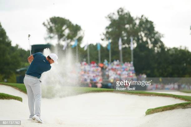 PGA Championship Rear view of Brooks Koepka in action chipping from sand trap during Friday play at Quail Hollow Club Charlotte NC CREDIT Robert Beck